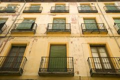 Green window shades of building in Avila Spain, an old Castilian Spanish village Stock Images