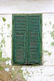 Green window shutters. And faded wall royalty free stock photography