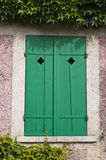 Green window somewhere in France. Nice green shuttered window in the French countryside near Giverny Royalty Free Stock Photo