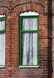 Green window, typical English red bricks house, close up. Manche Stock Photos