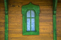 Green window on the wooden house Stock Photo