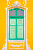 Green window and yellow wall. The Yellow Building and closed Green windows Stock Photography