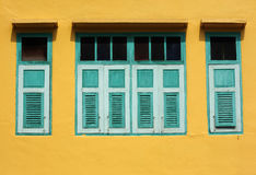 Green window on a yellow wall Royalty Free Stock Photos
