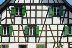 Green windows. Wooden house in switzerland with green windows Royalty Free Stock Photography