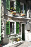 Green windows in old facade house. Green windows and door in an ancient and rural house - Old house facade - Italy royalty free stock photography