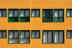 Green windows, orange facade Stock Photography