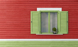 Green windows on red wooden wall Stock Images