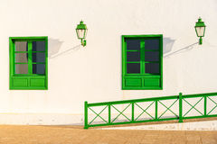 Green windows of white church building Royalty Free Stock Photos