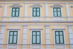 Green Windows on Yellow Vintage wall. Stock Images
