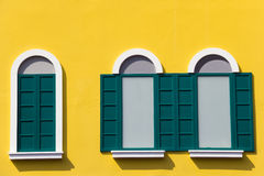 Green windows on yellow wall Window at The Venezia Stock Photo