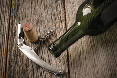 Green Wine Bottle and Cork with Red Wine Stock Image