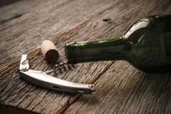 Green Wine Bottle and Cork with Red Wine Royalty Free Stock Photo