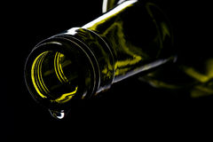 Green wine bottle with drop Stock Photography