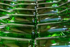 Green wine bottles filled with white wine stacked stock photography