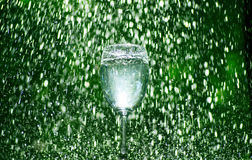 Green wine glass rain drop Royalty Free Stock Photo