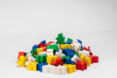 Green Winner Meeple on Top above everyome else. He is the winner, he is the best. stock photo