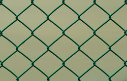 Green Wire Fence isolated on Brown Background, Horizontal Royalty Free Stock Images