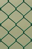 Green Wire Fence isolated on Brown Background, Vertical pattern. Green Wire Fence isolated on Brown Background, Closeup, Vertical pattern Royalty Free Stock Images