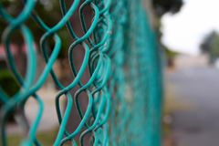 Green wire fence Stock Images