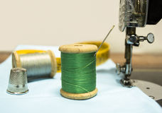 Green wire with a thimble Royalty Free Stock Photos