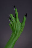 Green witch hand with black nails, real body-art Stock Images