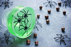 Green witch jello with spiders in a glass on Halloween Royalty Free Stock Photo
