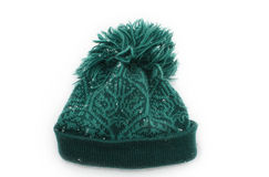 Green wollen hat in the snow. Green knittet wollen hat in the snow isolated on white Stock Images