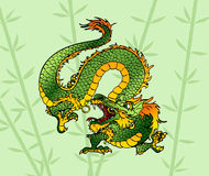 Green wood Asian dragon against a bamboo. Angry green wood Asian Chinese dragon against a bamboo backrgound Stock Photo
