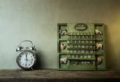 green wood calendar vintage and alarm clock on wood table end of Royalty Free Stock Images