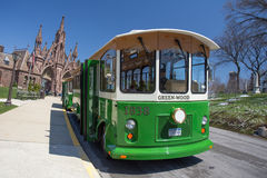 Green-wood Cemetery Trolley. BROOKLYN, NY - APRIL 16, 2014: Trolley bus tour  at historic Green-wood Cemetery in Brooklyn, NY.  Green-wood was founded in 1838 Royalty Free Stock Image