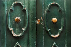 Green wood doors with gilded handles. Italian wood doors with gilded handles Stock Photos