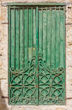 Green wood and iron pattern door Royalty Free Stock Images
