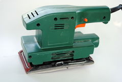 Green wood sander. Electrical wood sander with sandpaper sheet Stock Photos