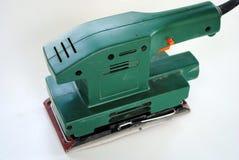 Green wood sander. Electrical wood sander with sandpaper sheet Stock Images