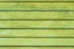 The green wood texture with natural patterns. Background Royalty Free Stock Images