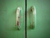 Green wood texture. With vintage door handles. Green wood texture. With vintage door handles Stock Images
