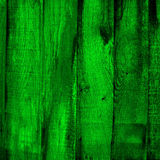 Green wooden background. A closeup of several wooden planks, painted in green Stock Photo