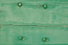 Green Wooden Background with Four Bolts Royalty Free Stock Image