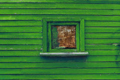 Green wooden background. Rusty window of old wooden house Royalty Free Stock Images