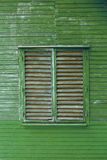 Green wooden background. Window of old wooden house Stock Photography