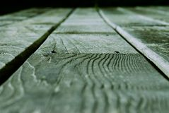 Green Wooden Board. Closeup of a wooden green board stock photo