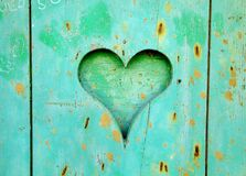 Green Wooden Board With Heart Hole Stock Images