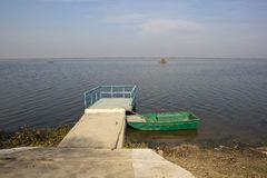 Harike wetlands with green boat Stock Images