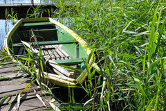 Green wooden boat moored at the pier Royalty Free Stock Photography