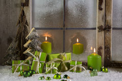 Green wooden christmas decoration with presents and candles. Royalty Free Stock Image