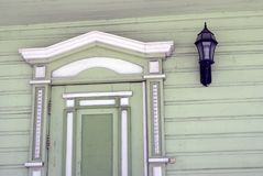 Green wooden countryhouse, facade and window. Color photo taken in Russia Stock Images