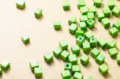 Green wooden cubic beads Royalty Free Stock Photography