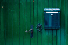 Green wooden door with mailbox Royalty Free Stock Image