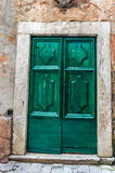 Green wooden door in old house Royalty Free Stock Image