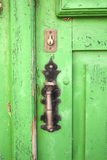 Green wooden door. Old wooden green door  with iron latch painted black Royalty Free Stock Photography